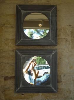 EUROPEAN ROUND MIRROR IN A ZINC FRAME
