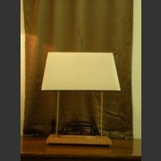 A VINTAGE HOLE PUNCH LAMP WITH CREAM LINEN SHADE